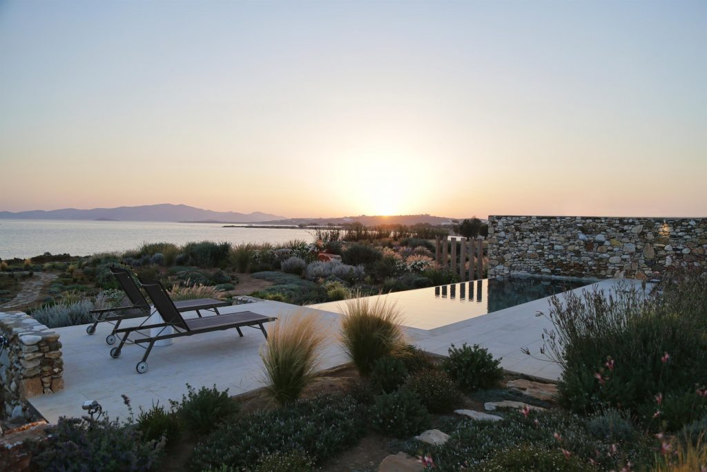 beautiful-villa-greece-sea-views-open-planned-swimming-pool-luxury-nighttime-exterior-jpg-jpg