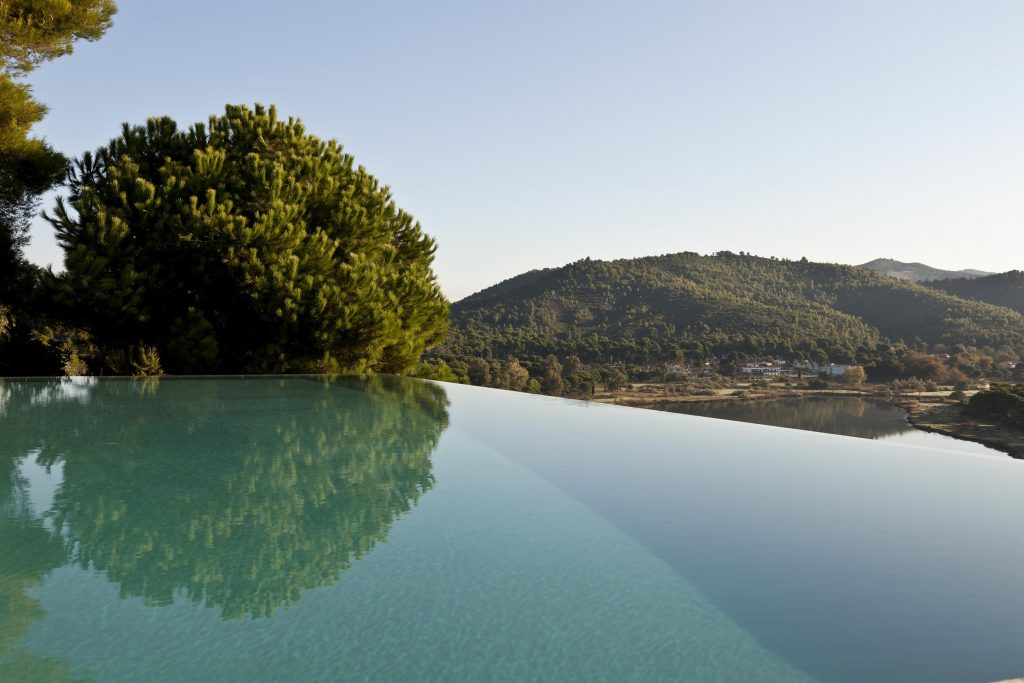 greece-an-iconic-modernist-retreat-surrounded-by-nature-pool-view162234778960b3100d2aed8-jpg