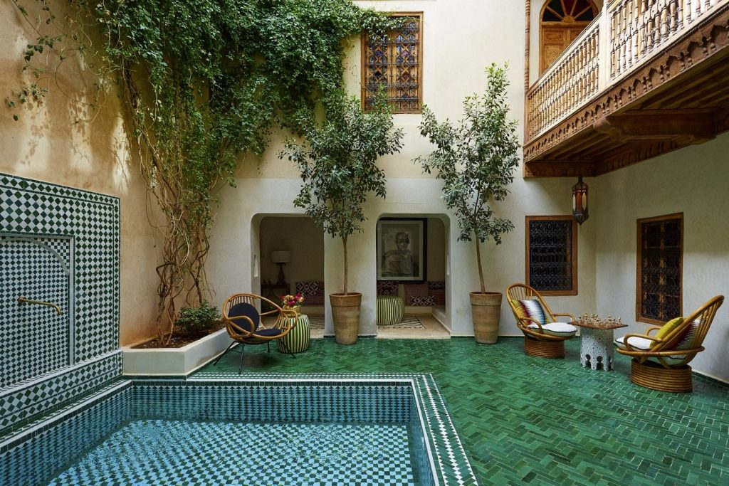 boutique-hotel-moroccan-plants-courtyard-yellow-morrocan-lamps-sweet-smell-great-views-swimming-pools-gardens-exterior-6162245464860b4b17878fe2-jpg