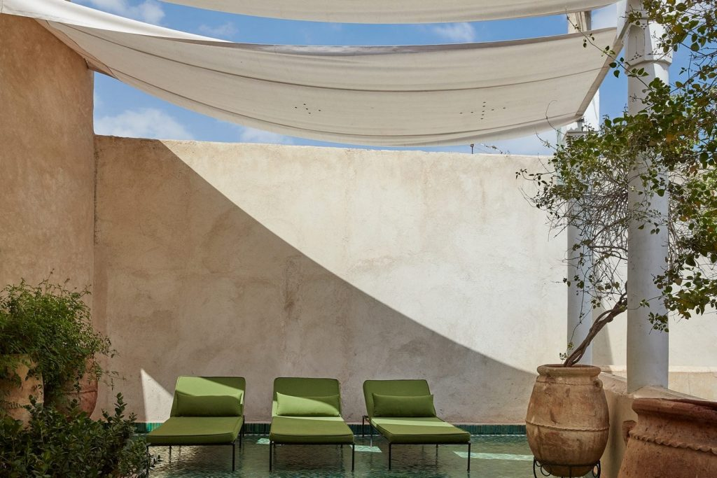 boutique-hotel-moroccan-plants-courtyard-yellow-morrocan-lamps-sweet-smell-great-views-swimming-pools-gardens-exterior-2162245466660b4b18a9614c-jpg