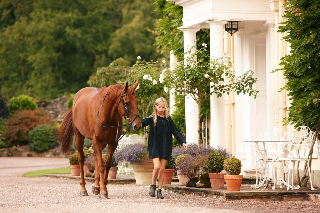 girl-walking-horse-passed-front-door162254129460b603ee2c9b3-jpg
